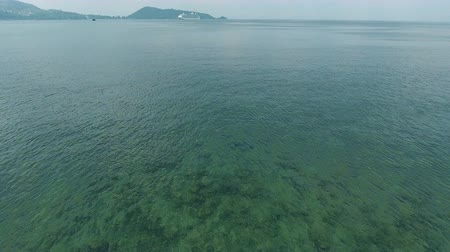 Aerial wide shot POV view of birds flying over the sea in the Andaman sea, Patong Phuket South of Thailand