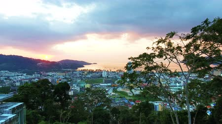 Aerial, 4K Landscape View of Patong Town In Phuket South of Thailand at sunset