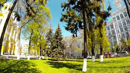 crucifix : Panoramic shooting of a park with a yellow church in Kiev