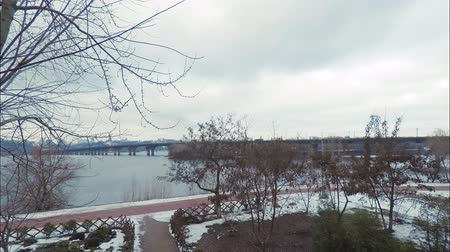 kiev : Time laps, view of the Paton Bridge over the Dnieper River in Kiev in the early spring morning, thick clouds through which sunlight sometimes breaks through