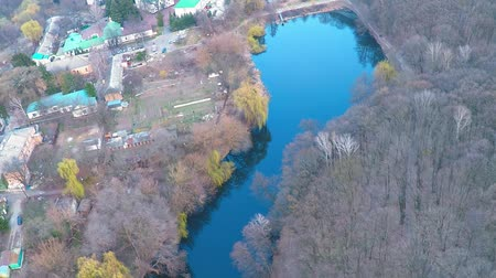 austerity : Flying over the monastery near the river in the forest