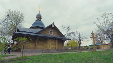 православие : 4K Hyperlaps. The wooden church in the old Russian style with a golden cross in the park of the city of Kiev