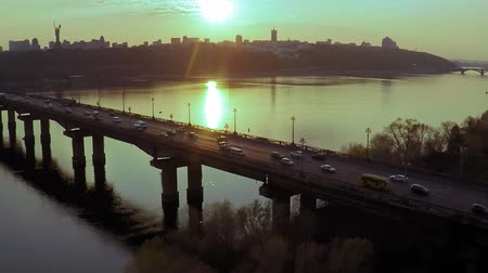 motherland : Aerial view of the Bridge across the wide Dnieper river in Kiev before sunset in spring Stock Footage