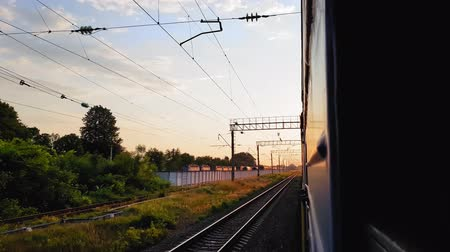 archief : The view from the high-speed train on the beautiful scenery with hills and forest before sunset. The view from the window of the car, bus, train. Journey from the train on a sunny day