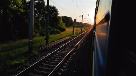 архив : The view from the high-speed train on the beautiful scenery with hills and forest before sunset. The view from the window of the car, bus, train. Journey from the train on a sunny day