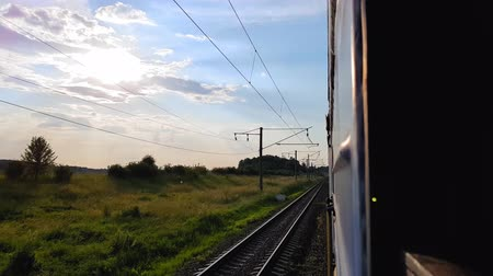 archívum : The view from the high-speed train on the beautiful scenery with hills and forest before sunset. The view from the window of the car, bus, train. Journey from the train on a sunny day