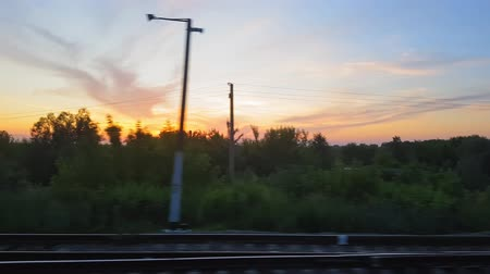 kiev : The view from the train on the beautiful scenery with hills and forest before sunset. The view from the window of the car, bus, train. Journey from the train. Stock Footage
