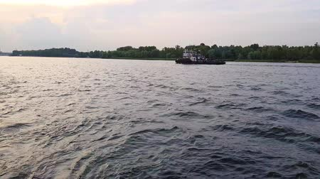 dockyard : 4K. Barge sails on the wide river of the Dnieper before the sunset