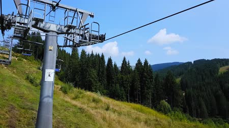 Cableway in the Carpathian mountains at the end of summer. 4K shooting cableway