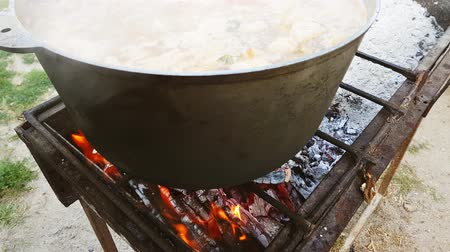 gulasz : Bograch. Soup with paprika, meat, bean, vegetable, dumpling. Traditional Hungarian Goulash in cauldron. Meal cooked outdoors on an open fire. Delicious and healthy food popular in Central Europe
