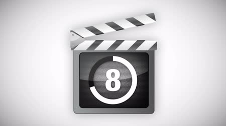 film şeridi : Animated clapperboard with countdown and noise effect.