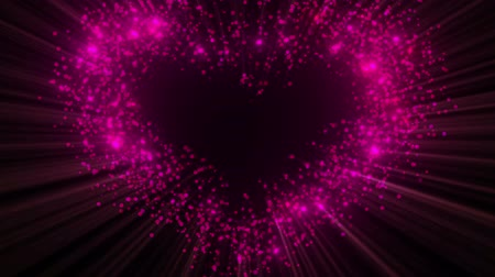 Abstract heart shape made of glitter particles with alpha channel. Seamless loop-able. Wideo