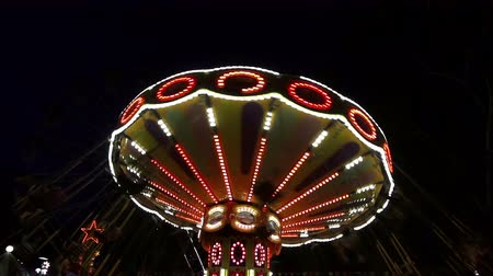 Fun carousel  in the evening in amusement park.