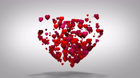 Heart shape valentines day background.  Many hearts form one big heart. Flying love red hearts on white background. Стоковые видеозаписи