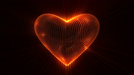Animated glowing heart against black background.  Vivid glowing heart with rays of light, the concept of love, looping animation.