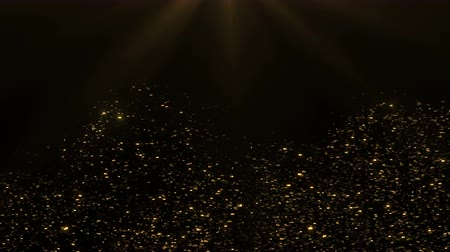 Shiny golden background. Abstract background with golden glitter particles. Progressive scan, seamlessly loop-able.