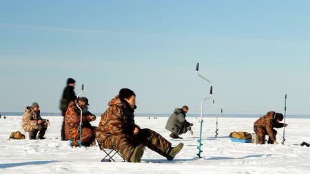 jasně : fishermen prepare for winter (subglacial) fishing competitions, formed groups discuss, agree, write instructions, prepare the equipment, collect things in trays from snowmobile trailers