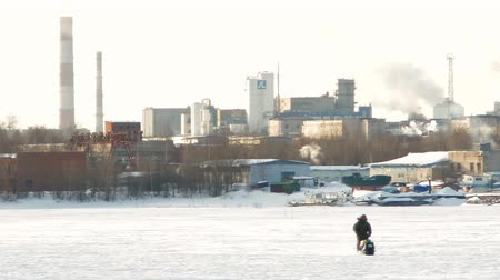 jasně : snowmobile rides on the background of factory chimneys and smoke