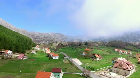 Швейцария : The house and the village in the mountains. The village Njegusi in Montenegro, on the mountain Lovcen. Aerial Photo drone.