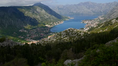 kotorska : Bay of Kotor from the heights. View from Mount Lovcen to the bay. View down from the observation platform on the mountain Lovcen. Mountains and bay in Montenegro. The liner near the old town of Kotor.