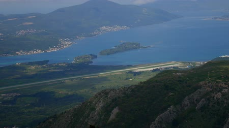 lovcen : View of the mountain Lovcen Tivat. Tivat Airport. Lustica Peninsula. Montenegrin coast. Stock Footage