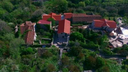 Elite hotel in the mountains of Montenegro. Ancient stone buildings with a tiled roof. Hotel in olive gardens.