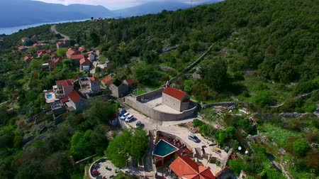 avusturya : Elite hotel in the mountains of Montenegro. Ancient stone buildings with a tiled roof. Hotel in olive gardens.
