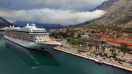 montengro : Viking Sea, a huge cruise ship in the Bay of Kotor in Montenegro. Near the old town of Kotor. Aerial Photo drone. A beautiful country to travel.