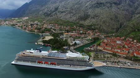 montengro : Huge cruise ship in the Bay of Kotor in Montenegro. Near the old town of Kotor. Aerial Photo drone. A beautiful country to travel.