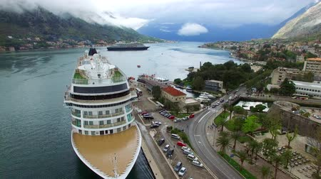 heritage : Viking Sea, a huge cruise ship in the Bay of Kotor in Montenegro. Near the old town of Kotor. Aerial Photo drone. A beautiful country to travel.