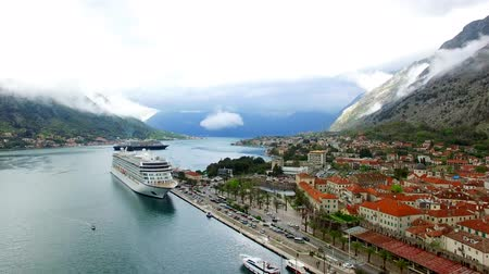 montengro : Huge Viking cruise ship in the Bay of Kotor in Montenegro. Near the old town of Kotor. Aerial Photo drone. A beautiful country to travel. Stock Footage