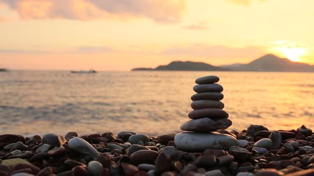 stacked rock : Balance stones on the beach. Peace of mind. Equilibrium life. Calming nerves.