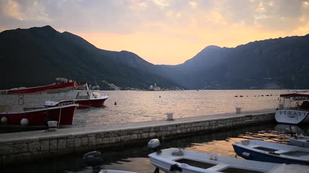 балканский : The old town of Perast on the shore of Kotor Bay, Montenegro. The ancient architecture of the Adriatic and the Balkans. Boats and yachts on the dock.