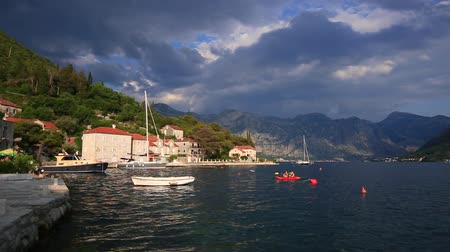 boka : The old town of Perast on the shore of Kotor Bay, Montenegro. The ancient architecture of the Adriatic and the Balkans. Aerial survey of drones from a height. Stock Footage