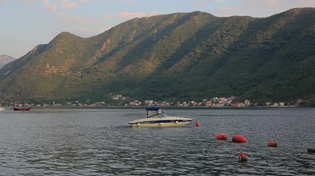 балканский : Boat in the Bay of Kotor. Montenegro, the water of the Adriatic Sea. Boats, yachts, liners.