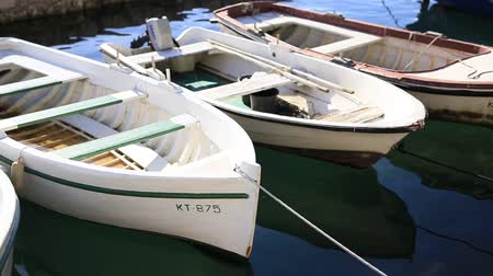 small vessels : Wooden boats on the water. In the Bay of Kotor in Montenegro. Marine boats. Stock Footage