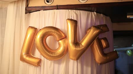 pocztówka : The inscription Love from the golden balloons. Wideo
