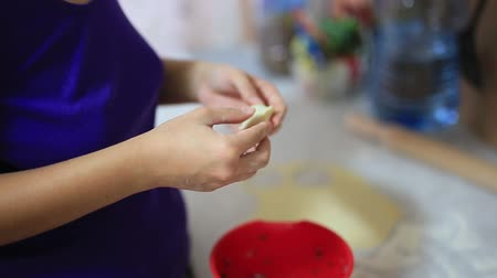 клецка : She sculpts dumplings in the kitchen. Girl cooking food.