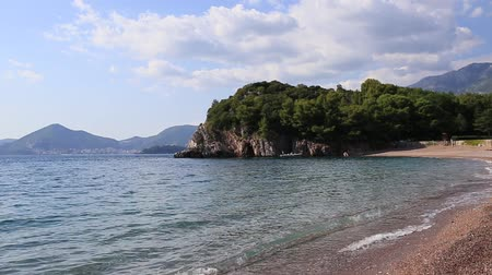 gora : Queens Beach in the territory of the park Milocer, near the villa, in Montenegro, the Adriatic. Stock Footage