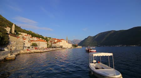 kotorska : The old town of Perast on the shore of Kotor Bay, Montenegro. The ancient architecture of the Adriatic and the Balkans. Fishermens cities of Europe.