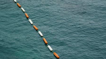 ancorado : Buoys in the sea. Restrictive and rescue buoys in the sea