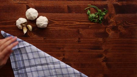 accessories : Wooden table for cooking. Garlic on a wooden texture. Stock Footage