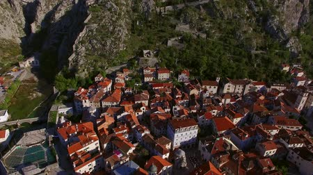 eski şehir : The Old Town of Kotor. Flying over the city. Aerial survey by a drone. Montenegro Stok Video