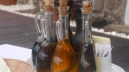 ocet : Bottles with seasonings in a fishing cafe in Montenegro. Cork stoppers, glass body. Wideo