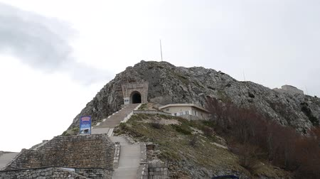 lovcen : Mausoleum of Njegos on the Mount Lovcen in Montenegro. Aerial survey by a drone. The highest mountain on the coast of Montenegro. Peak. Stock Footage