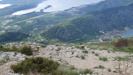 lovcen : Benches on Mount Lovcen, overlooking the Bay of Kotor in Montenegro. Stock Footage