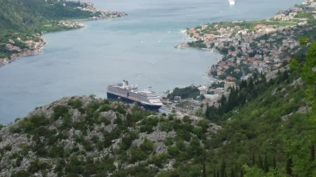 lovcen : Bay of Kotor from the heights. View from Mount Lovcen to the bay. View down from the observation platform on the mountain Lovcen. Mountains and bay in Montenegro. The liner near the old town of Kotor.