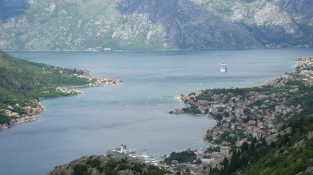 balkan : Bay of Kotor from the heights. View from Mount Lovcen to the bay. View down from the observation platform on the mountain Lovcen. Mountains and bay in Montenegro. The liner near the old town of Kotor.