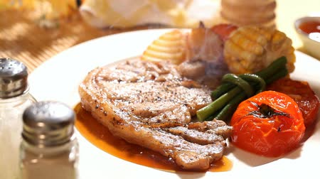 diner : Pork chop steak serve with vegetable in restaurant Stock Footage