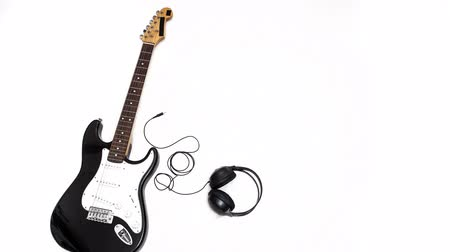 Stop motion electric guitar with headphone Стоковые видеозаписи